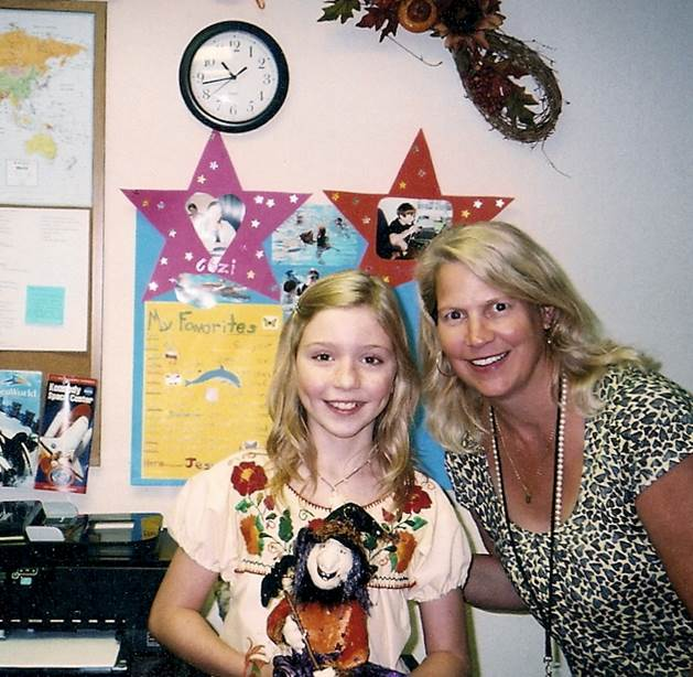 "Studio Teacher Josie Batorski with ""Dolphin Tale"" star Cozi Zuehlsdorff during filming."